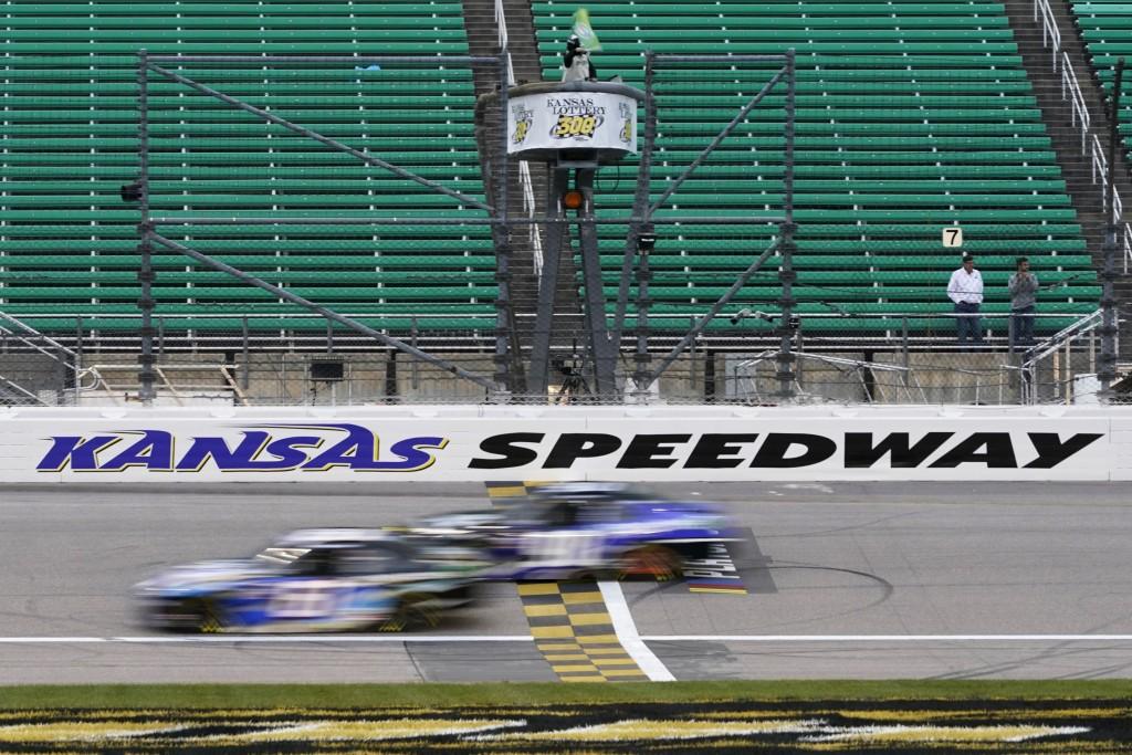 Drivers take the green flag during a NASCAR Xfinity Series auto race at Kansas Speedway in Kansas City, Kan., Saturday, Oct. 17, 2020. (AP Photo/Orlin...