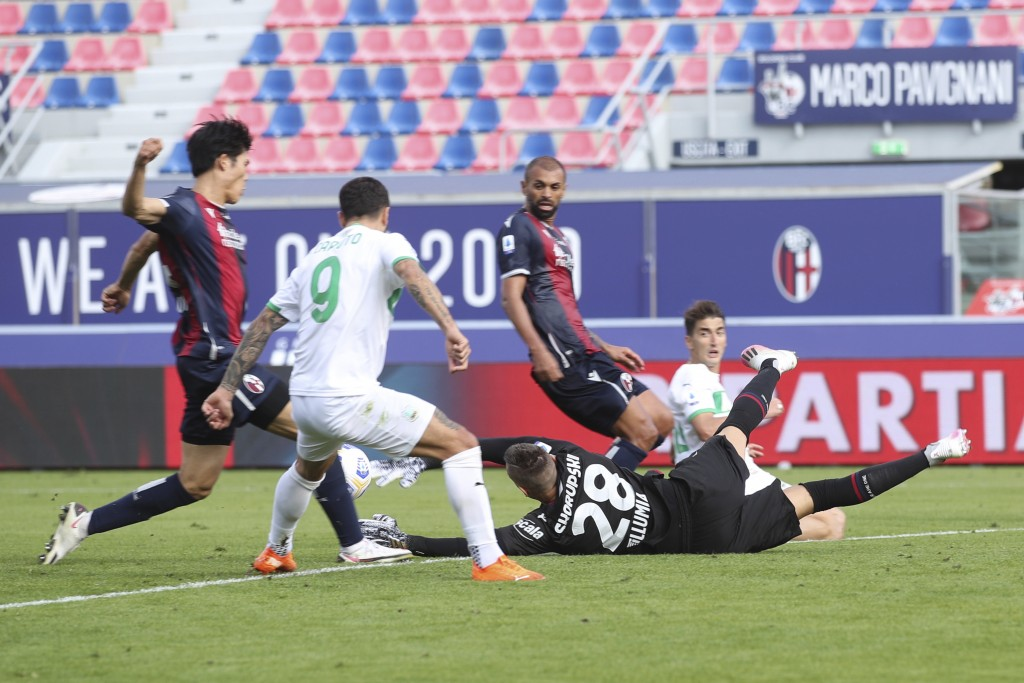 Bologna's Takehiro Tomiyasu, left, scores an own goal during the Serie A soccer match between Bologna and Sassuolo at the Renato Dall'Ara Stadium in B...