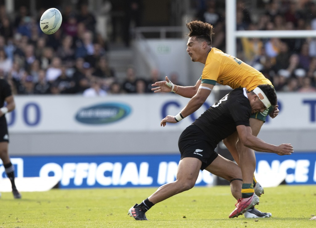 Australia's Jordan Petaia is tackled by New Zealand's Anton Lienert-Brown during the second Bledisloe Rugby test between the All Blacks and the Wallab...