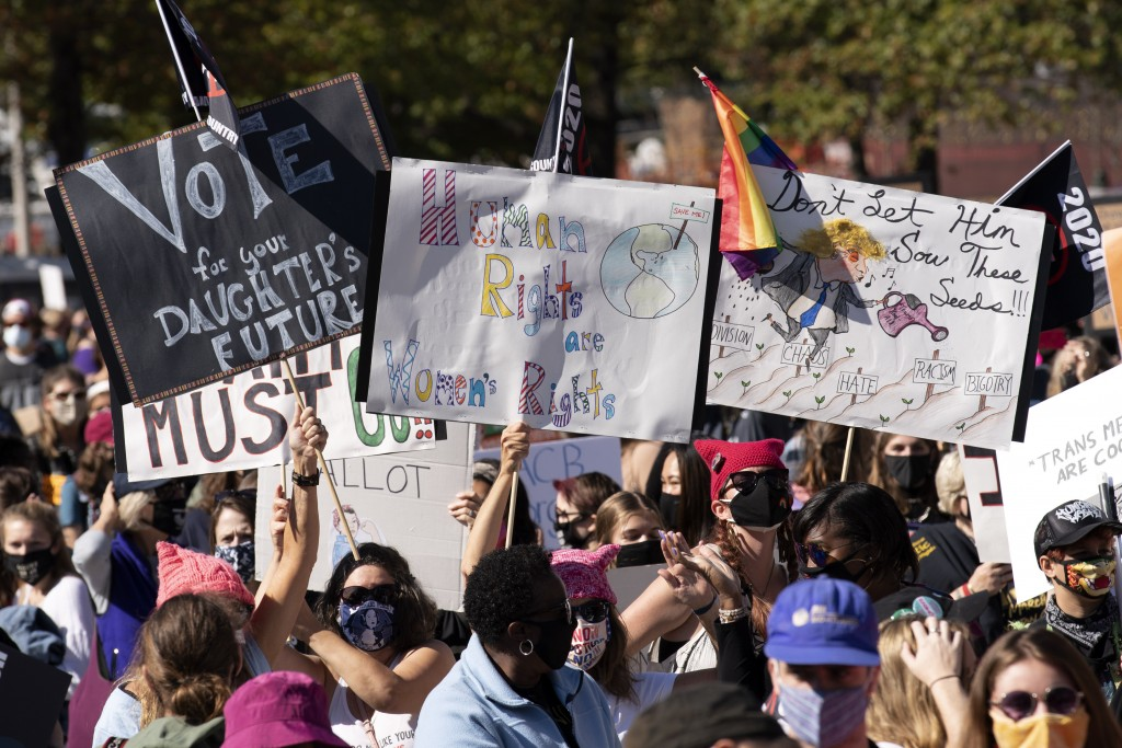 Protestors rally during the Women's March at Freedom Plaza, Saturday, Oct. 17, 2020, in Washington. (AP Photo/Jose Luis Magana)