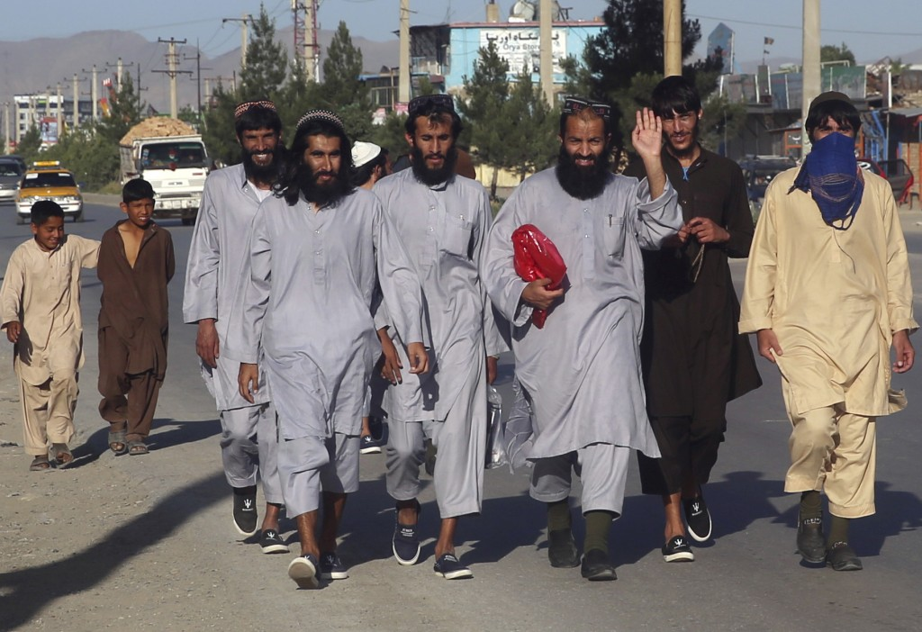 In this Tuesday, May 26, 2020 file photo, Afghan Taliban prisoners freed from Bagram prison walk in Kabul, Afghanistan. TAfghanistan has been at war f...