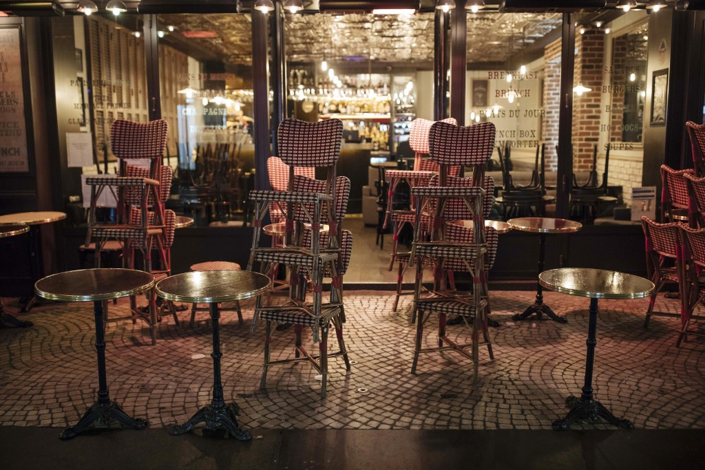 A bar terrace is closed to meet the curfew in Paris, Saturday Oct. 17, 2020. French restaurants, cinemas and theaters are trying to figure out how to ...