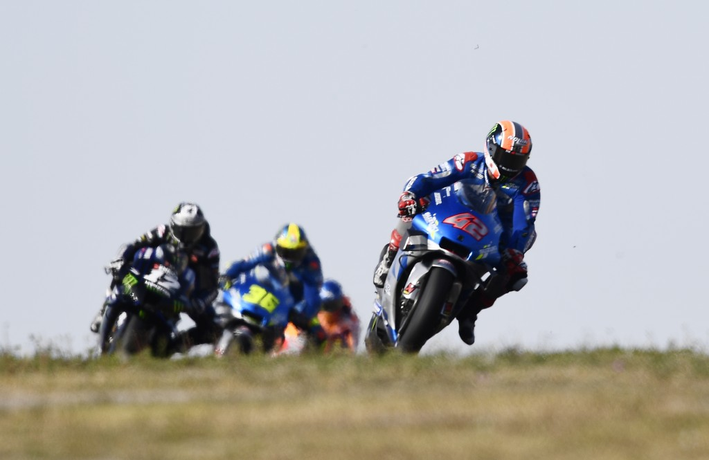 Spain's Alex Rins rides his Suzuki during the Aragon Motorcycle Grand Prix at the Motorland circuit in Alcaniz, Spain, Sunday, Oct. 18, 2020. (AP Phot...