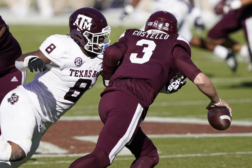 Texas A&M defensive lineman DeMarvin Leal (8) sacks Mississippi State quarterback K.J. Costello (3) during the first half of an NCAA college football ...
