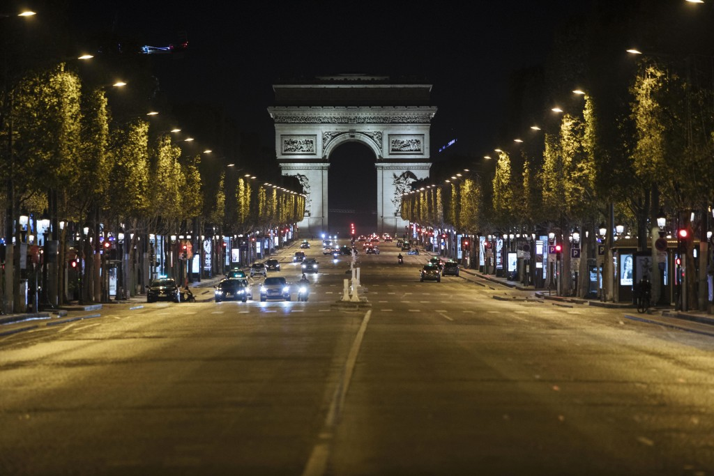 Champs-Elysees avenue is almost empty during curfew in Paris, Saturday, Oct. 17, 2020. French restaurants, cinemas and theaters are trying to figure o...