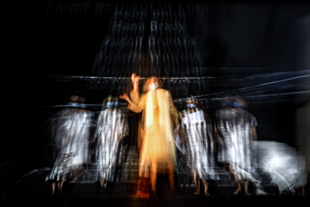 In this photograph shot with a slow shutter speed Romanian Jewish actress Maia Morgernstern, center, performs alongside fellow actresses of the Jewish...