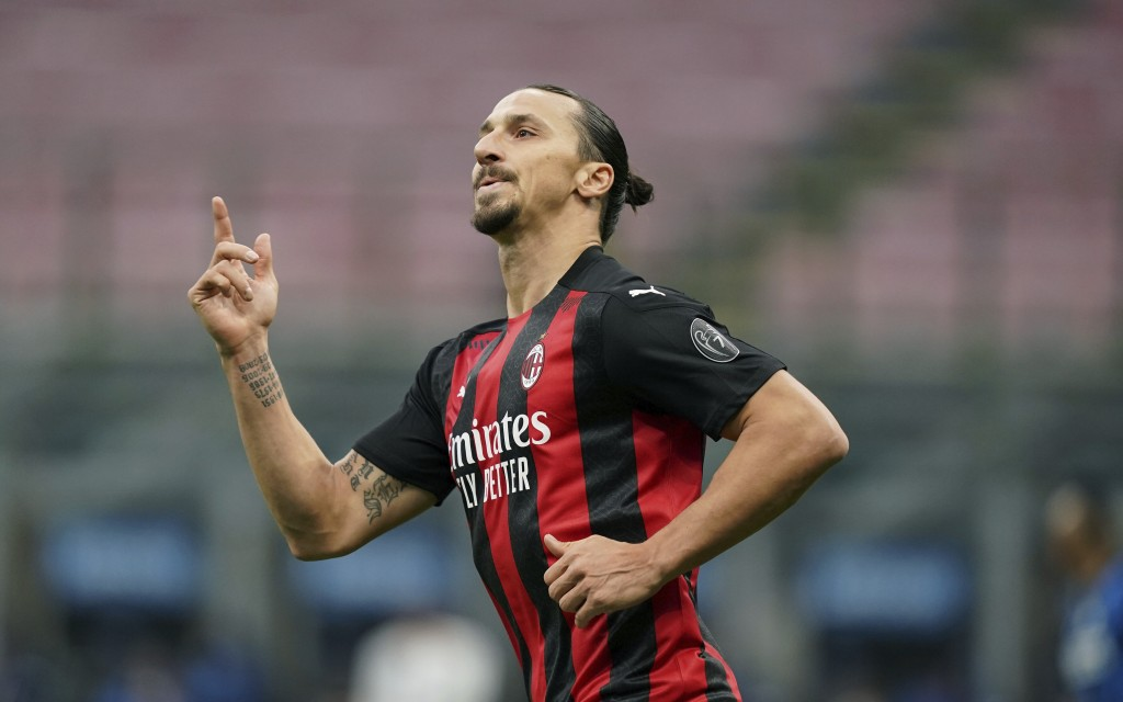 AC Milan's Zlatan Ibrahimovic celebrates after scoring scores his side's first goal during the Serie A soccer match between Inter Milan and AC Milan a...