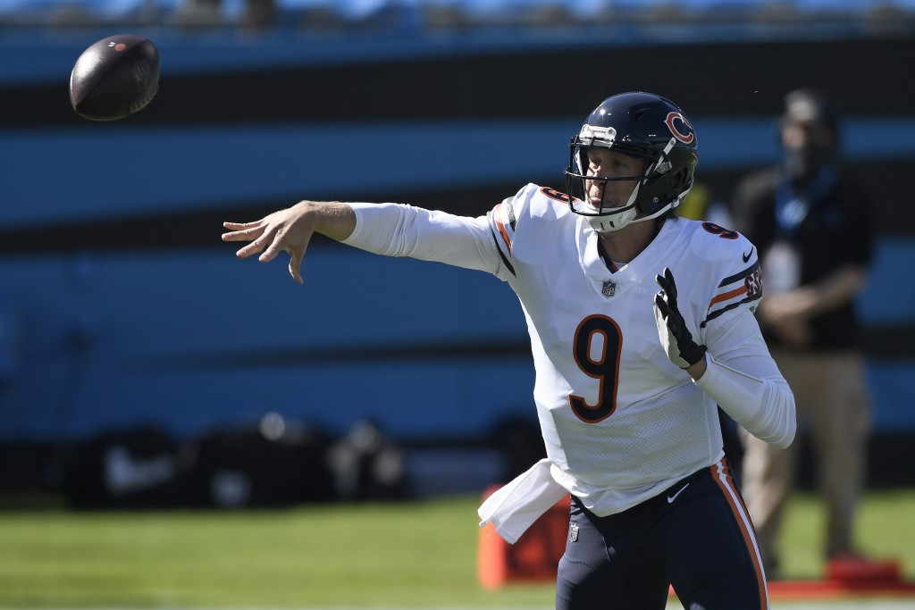 Chicago Bears quarterback Nick Foles (9) passes against the Carolina Panthers during the first half of an NFL football game in Charlotte, N.C., Sunday...