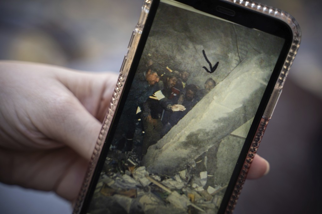 Lucía Ruiz, who survived an attack by the Basque separatist militant group ETA in 1987 when she was 10 years old, shows a photo of rescue efforts at t...