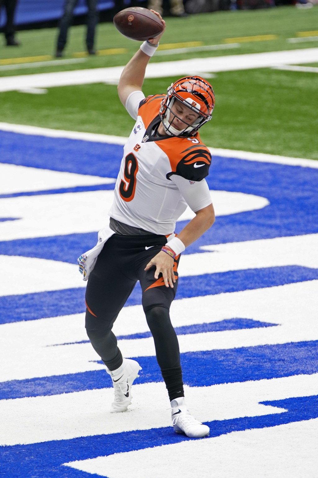 Cincinnati Bengals quarterback Joe Burrow (9) celebrates after rushing for a touchdown during the first half of an NFL football game against the India...