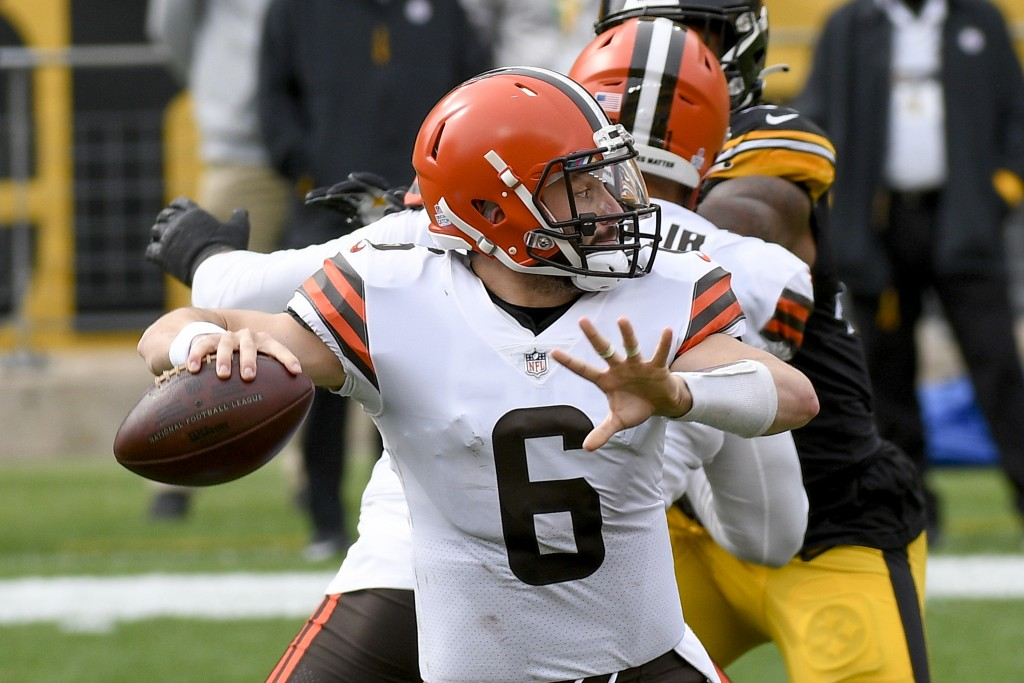 Cleveland Browns quarterback Baker Mayfield (6) looks to pass against the Pittsburgh Steelers during the first half of an NFL football game, Sunday, O...