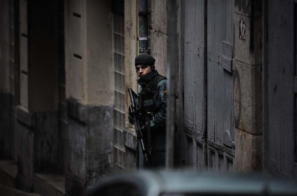 FILE - In this March 1, 2011 file photo, a Spanish Civil Guard stands next to the building where they arrested four alleged member of the Basque separ...