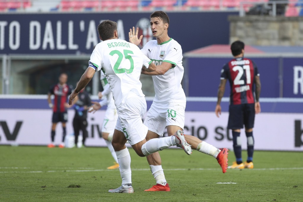 Sassuolo's Filip Djuricic celebrates with his teammate Domenico Berardi, left, after scoring during the Serie A soccer match between Bologna and Sassu...