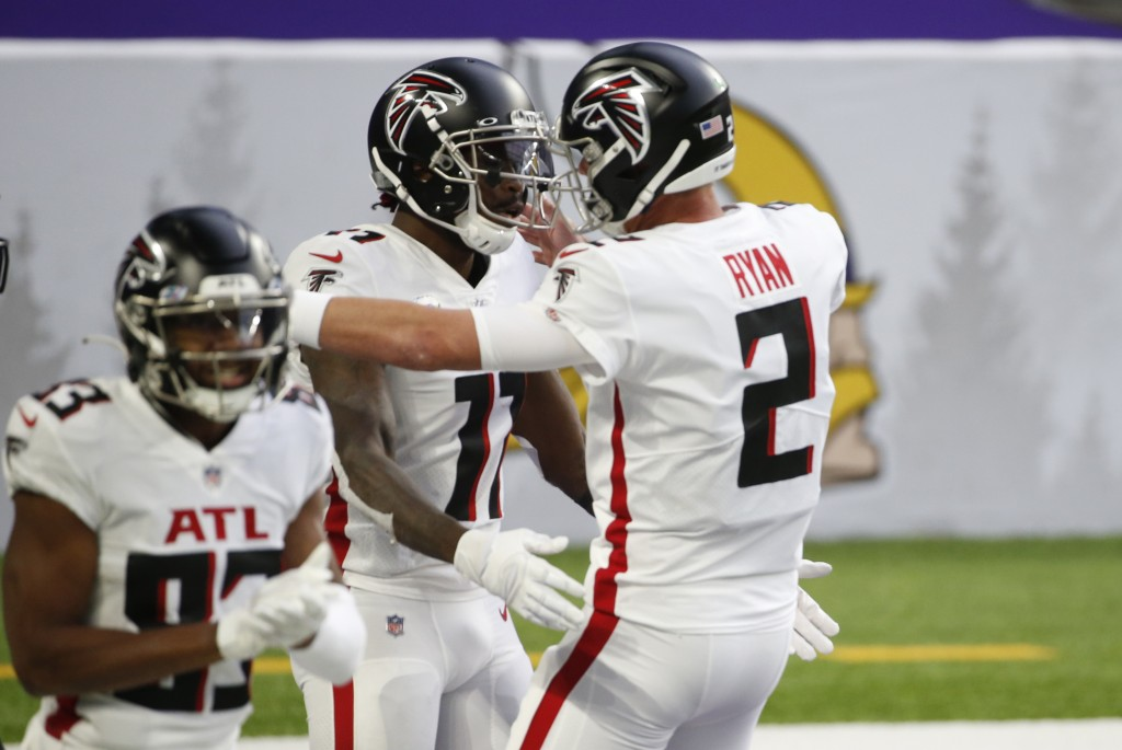 Atlanta Falcons wide receiver Julio Jones, left, celebrates with teammate Matt Ryan (2) after catching a 20-yard touchdown pass during the first half ...