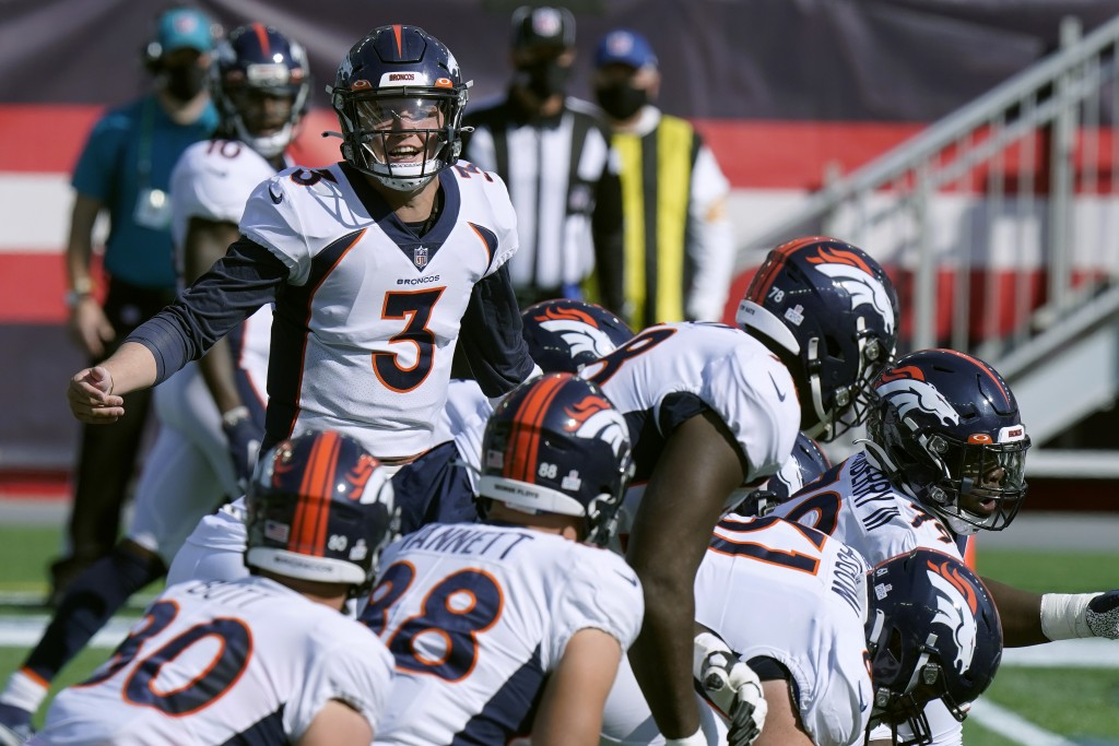 Denver Broncos quarterback Drew Lock (3) calls signals at the line of scrimmage in the first half of an NFL football game against the New England Patr...