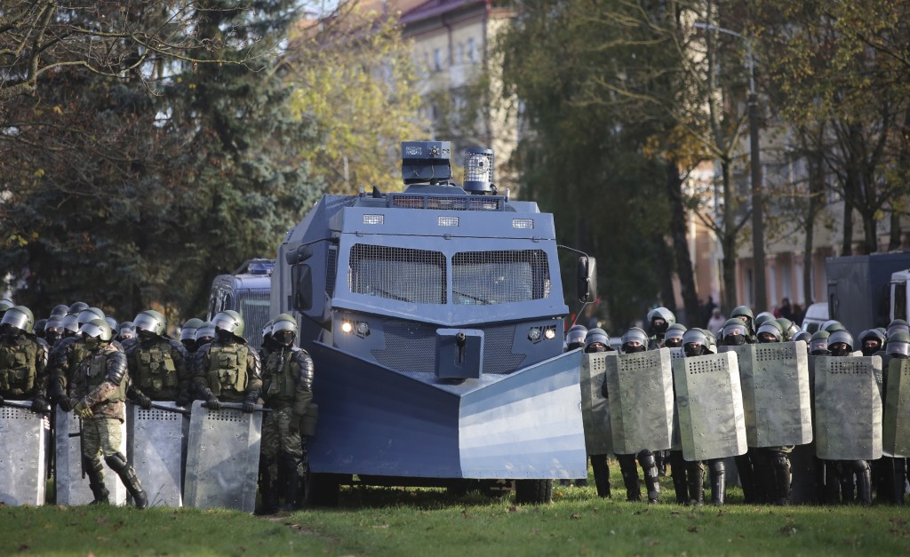 Police block the territory to against an opposition rally protesting the official presidential election results in Minsk, Belarus, Sunday, Oct. 18, 20...