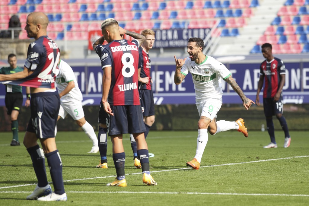 Sassuolo's Francesco Caputo celebrates after scoring during the Serie A soccer match between Bologna and Sassuolo at the Renato Dall'Ara Stadium in Bo...