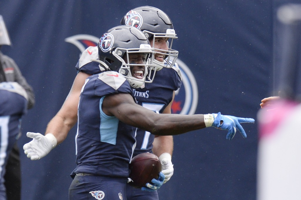 Tennessee Titans wide receiver A.J. Brown, front, celebrates after scoring a touchdown against the Houston Texans in the first half of an NFL football...