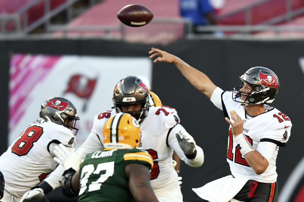 Tampa Bay Buccaneers quarterback Tom Brady (12) throws a pass against the Green Bay Packers during the second half of an NFL football game Sunday, Oct...