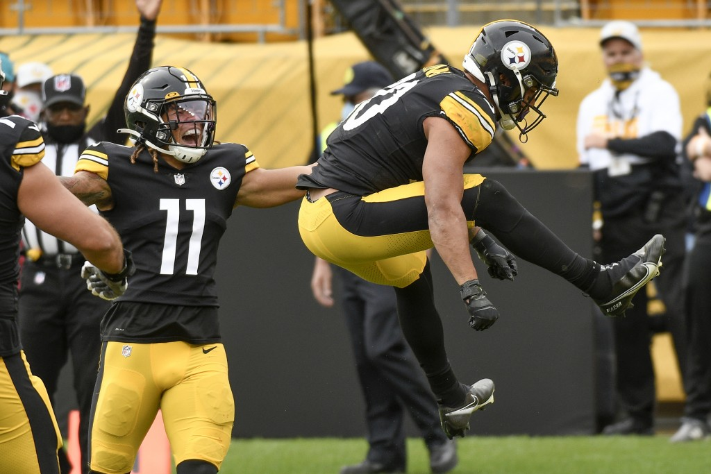 Pittsburgh Steelers running back James Conner (30) leaps after scoring a touchdown against the Cleveland Browns during the first half of an NFL footba...