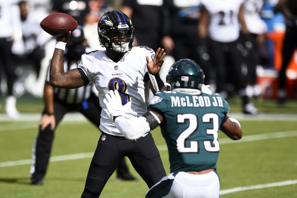 Baltimore Ravens' Lamar Jackson (8) tries to pass against Philadelphia Eagles' Rodney McLeod (23) during the first half of an NFL football game, Sunda...