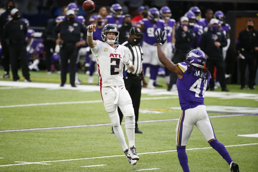 Atlanta Falcons quarterback Matt Ryan (2) throws a pass over Minnesota Vikings safety Anthony Harris (41) during the first half of an NFL football gam...