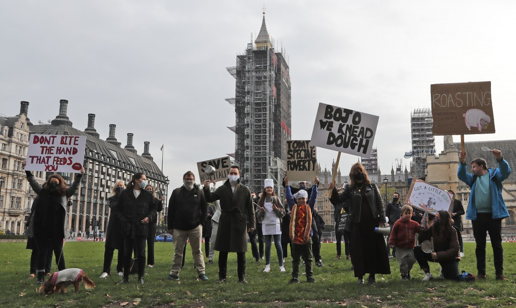 Hospitality workers protest in Parliament Square in London, Monday, Oct. 19, 2020. Hospitality workers are demonstrating outside Parliament against to...