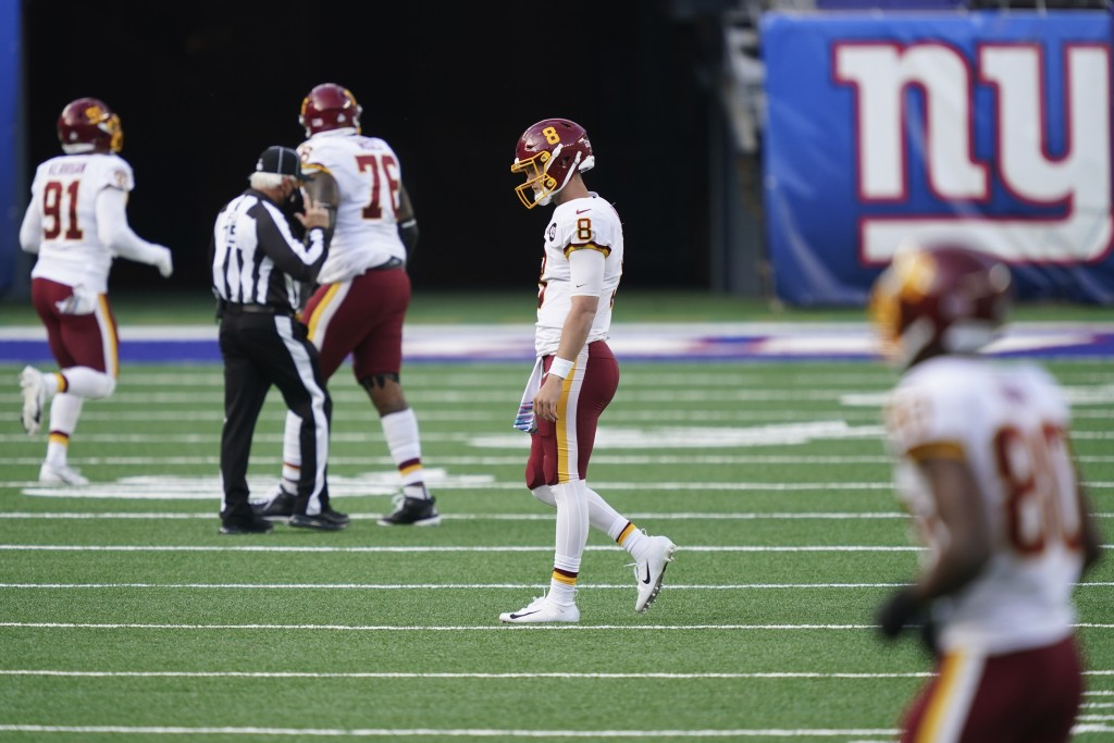 Washington Football Team quarterback Kyle Allen (8) reacts after fumbling the ball during the second half of an NFL football game against the New York...