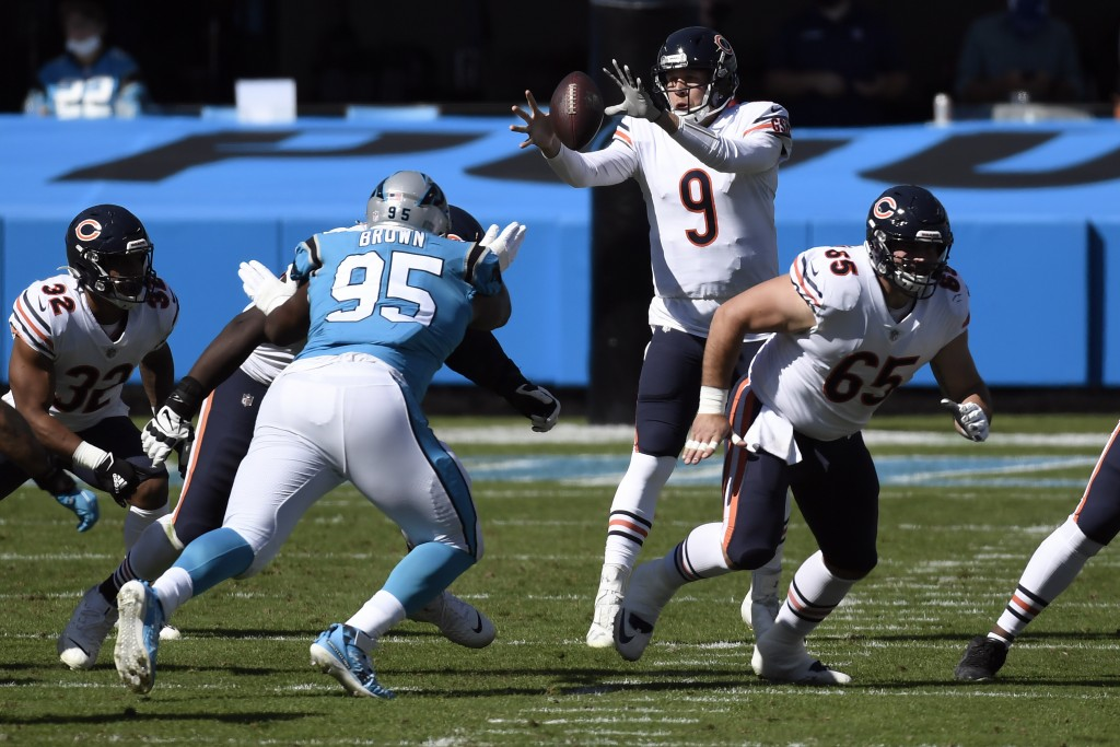 Chicago Bears quarterback Nick Foles (9) reaches for the ball during the first half of an NFL football game against the Carolina Panthers in Charlotte...