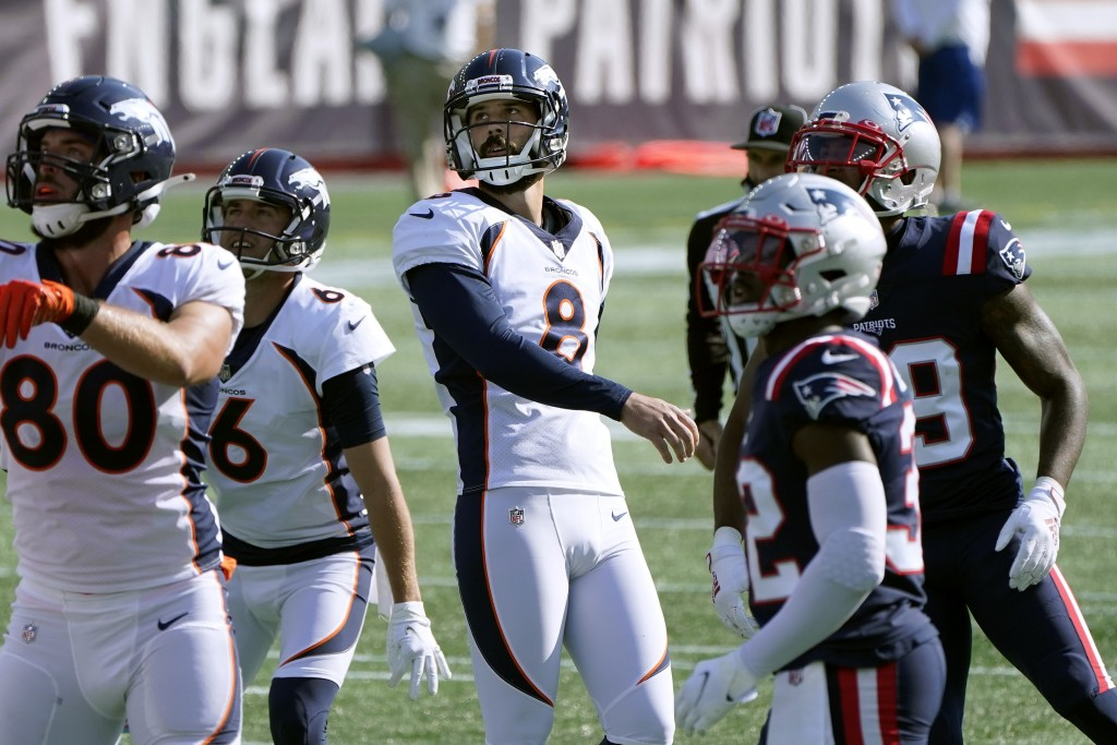 Denver Broncos kicker Brandon McManus (8) watches one of his four successful field goal attempts in the first half of an NFL football game against the...