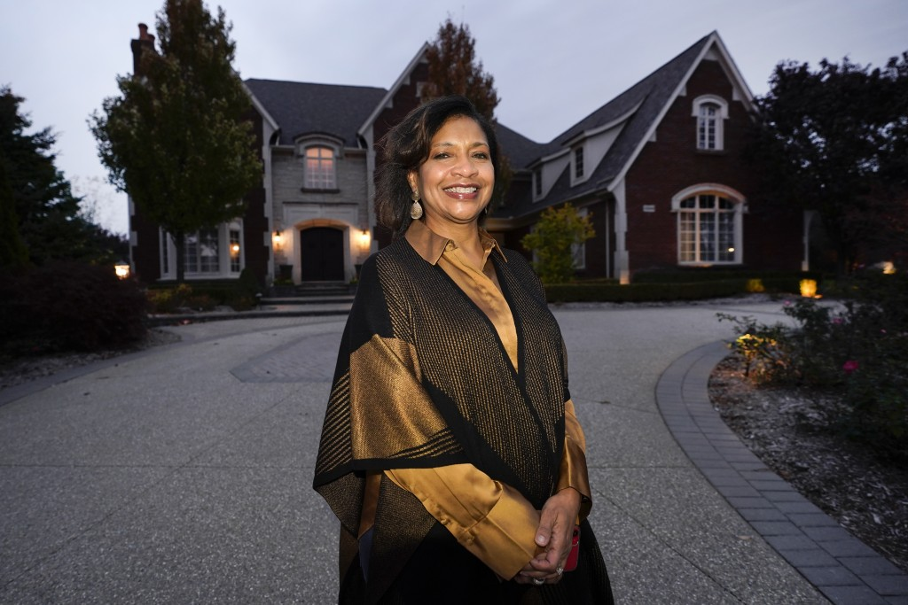 Alison Jones poses for a portrait outside her home in Rochester, Mich., Wednesday, Oct. 14, 2020. Trump's description of the suburbs seems to Jones li...