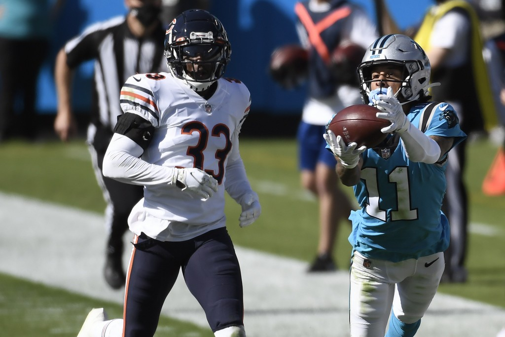 Carolina Panthers wide receiver Robby Anderson (11) catches a pass while Chicago Bears cornerback Jaylon Johnson (33) chases during the second half of...