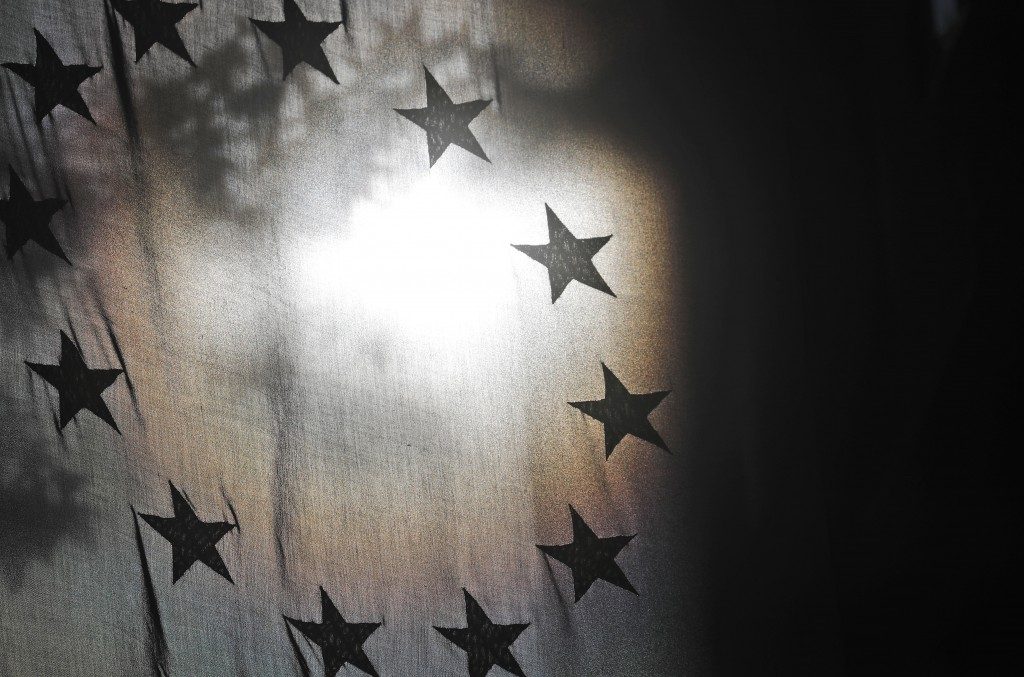 The stars of the EU flag are seen against the sun at the Europa House in London, Monday, Oct. 19, 2020. According to media reports, European Commissio...