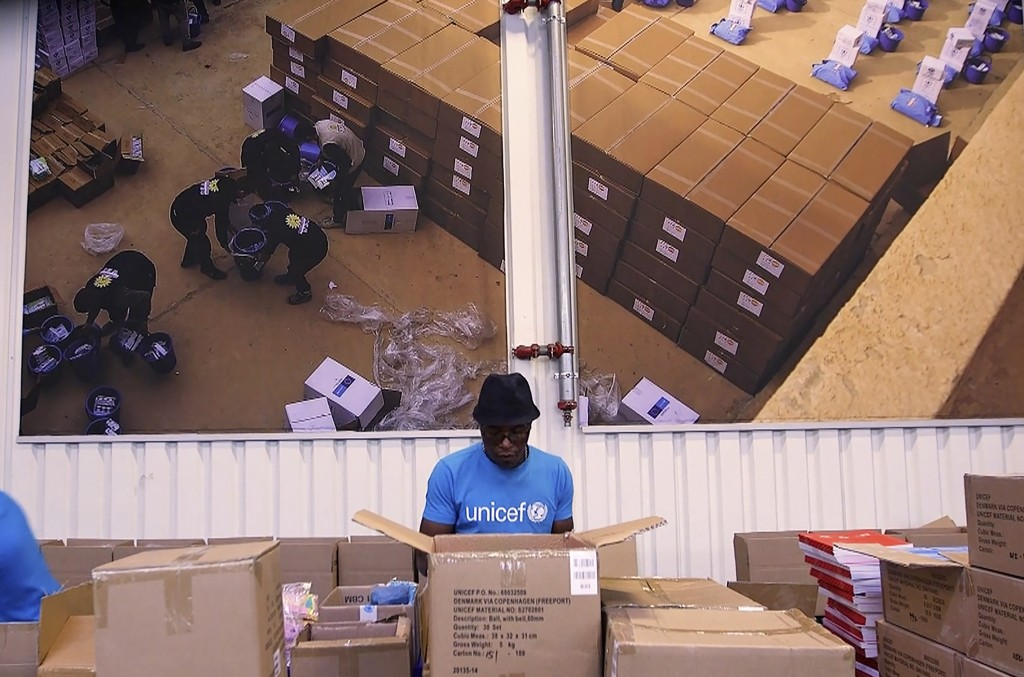 This image taken from video shows people working inside the UNICEF warehouse, the world's largest humanitarian aid warehouse, in Copenhagen, Denmark ,...