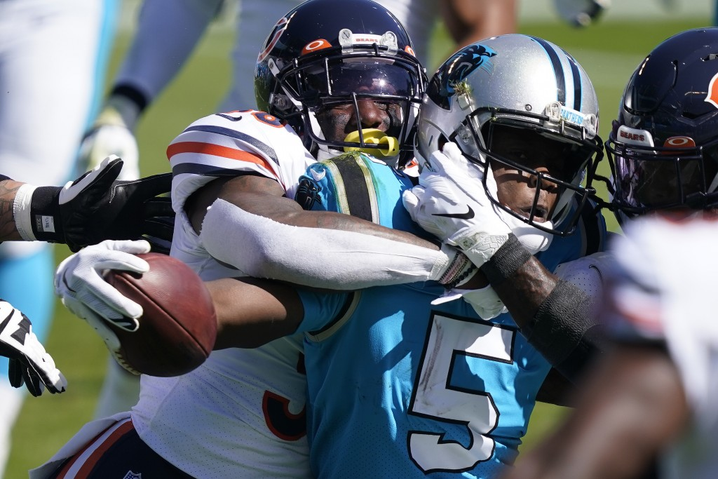 Chicago Bears strong safety Tashaun Gipson tackles Carolina Panthers quarterback Teddy Bridgewater (5) during the first half of an NFL football game i...