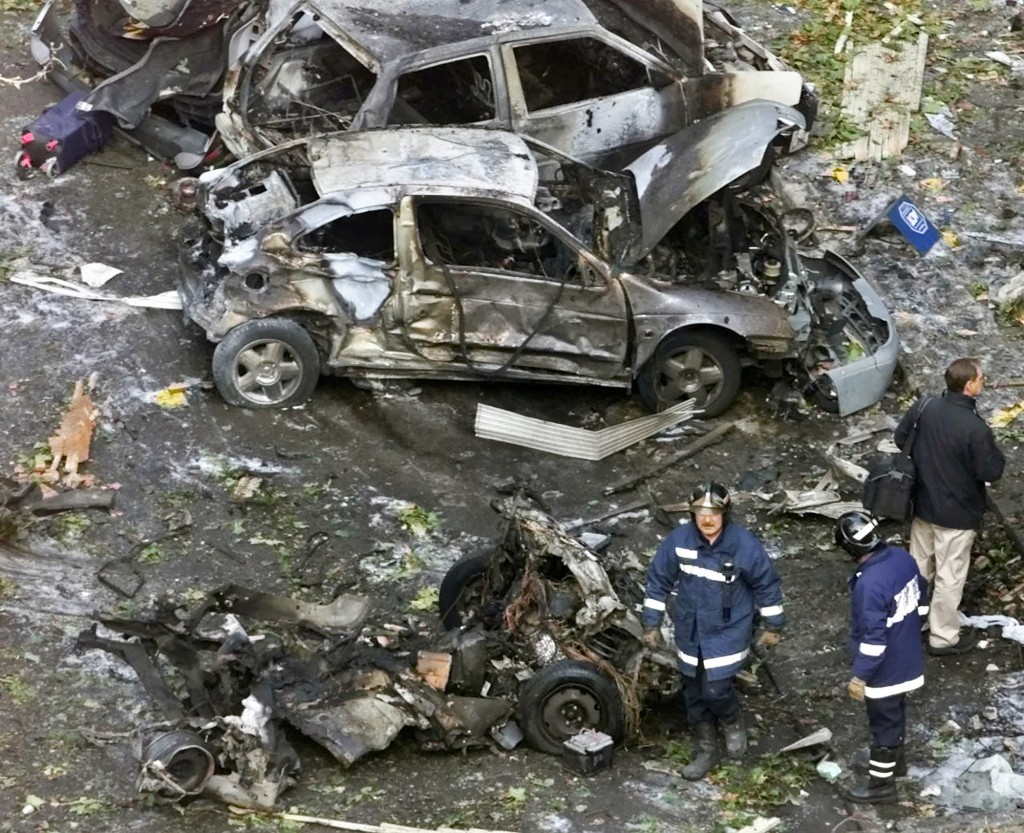 FILE - In this Nov. 6, 2001 file photo, firefighters work at the scene of a car bomb in Madrid. Josu Urrutikoetxea, the last known chief of ETA, the n...