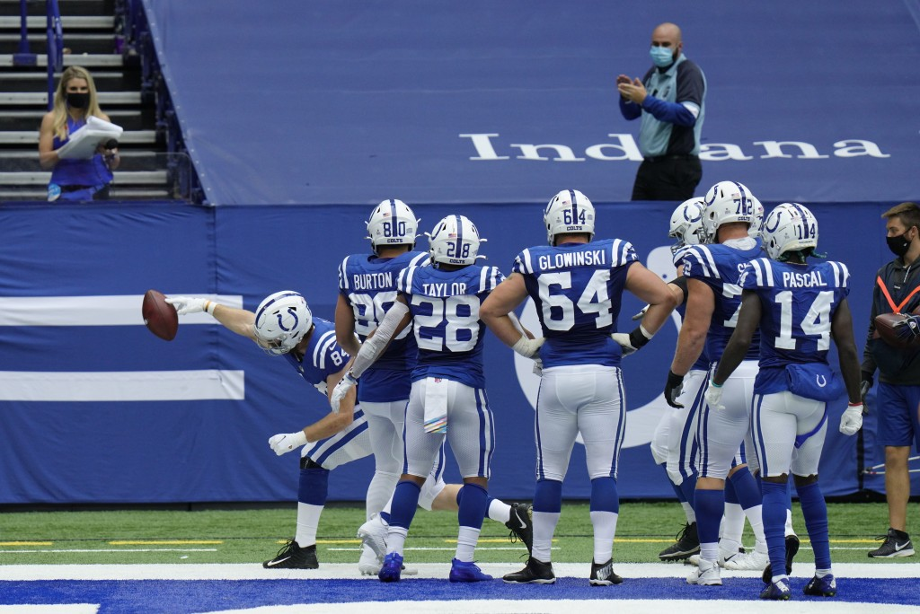 Indianapolis Colts' Jack Doyle (84) celebrates a touchdown reception during the second half of an NFL football game against the Cincinnati Bengals, Su...