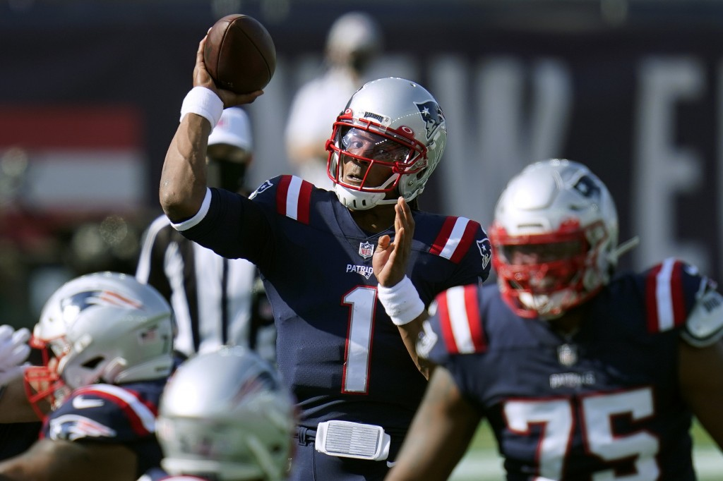 New England Patriots quarterback Cam Newton (1) passes against the Denver Broncos in the first half of an NFL football game, Sunday, Oct. 18, 2020, in...