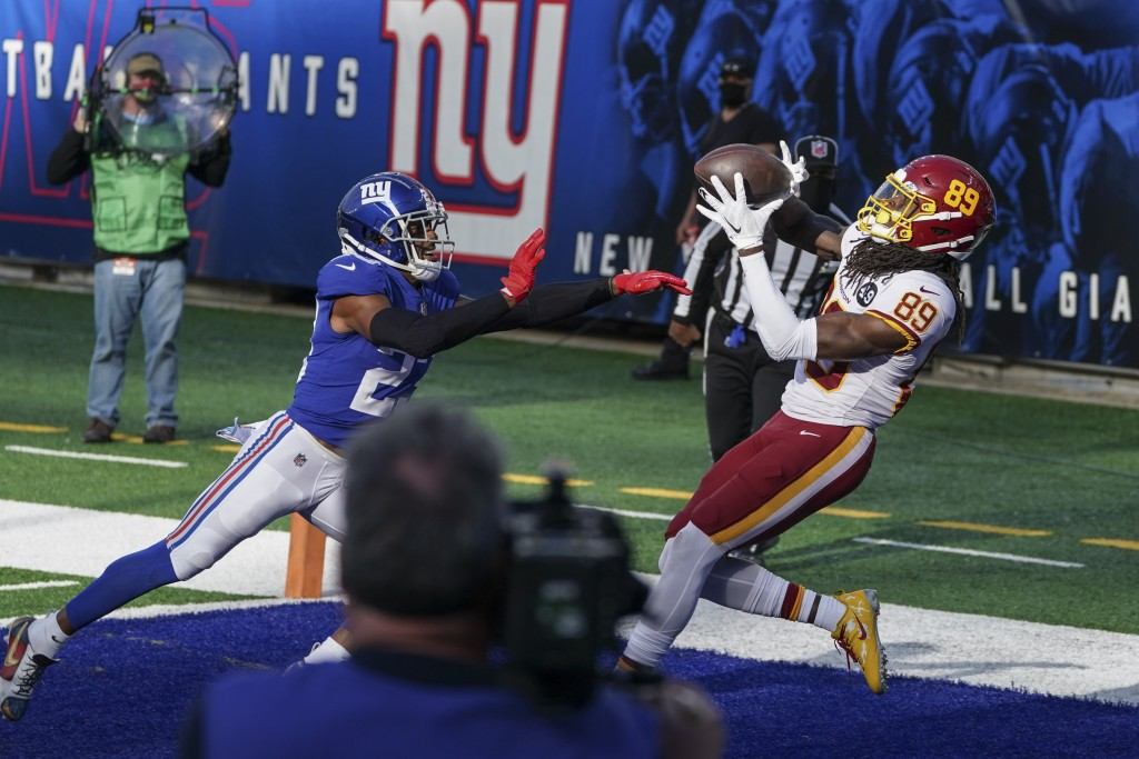 Washington Football Team wide receiver Cam Sims (89) catches a pass for a touchdown in front of New York Giants' Logan Ryan (23) during the second hal...