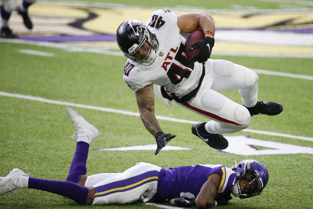 Atlanta Falcons fullback Keith Smith (40) is tackled by Minnesota Vikings cornerback Cameron Dantzler after catching a pass during the first half of a...