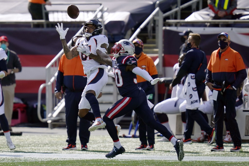 Denver Broncos wide receiver Tim Patrick (81) catches a pass as New England Patriots cornerback Jason McCourty (30) defends in the first half of an NF...