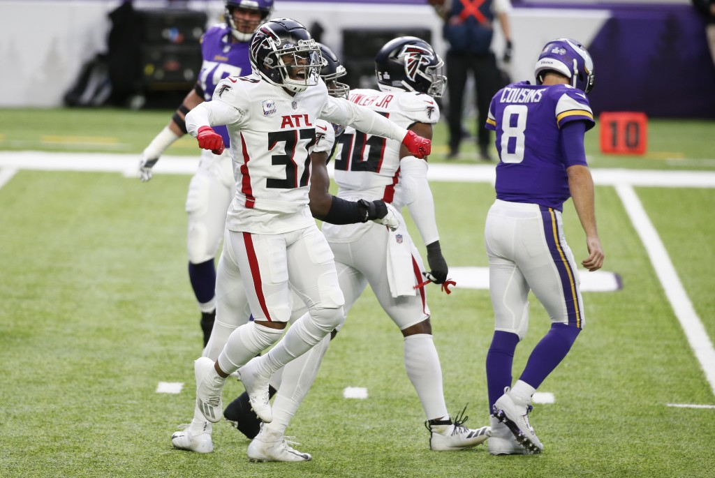 Atlanta Falcons safety Ricardo Allen celebrates in front of Minnesota Vikings quarterback Kirk Cousins (8) after a defensive stop during the first hal...