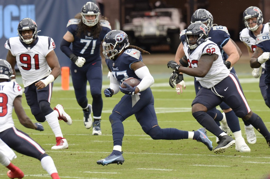 Tennessee Titans running back Derrick Henry (22) carries the ball against the Houston Texans in the first half of an NFL football game Sunday, Oct. 18...
