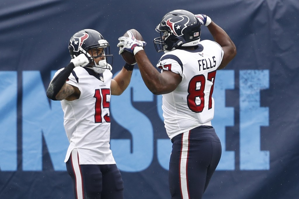 Houston Texans tight end Darren Fells (87) celebrates with wide receiver Will Fuller (15) after Fells caught a touchdown pass against the Tennessee Ti...