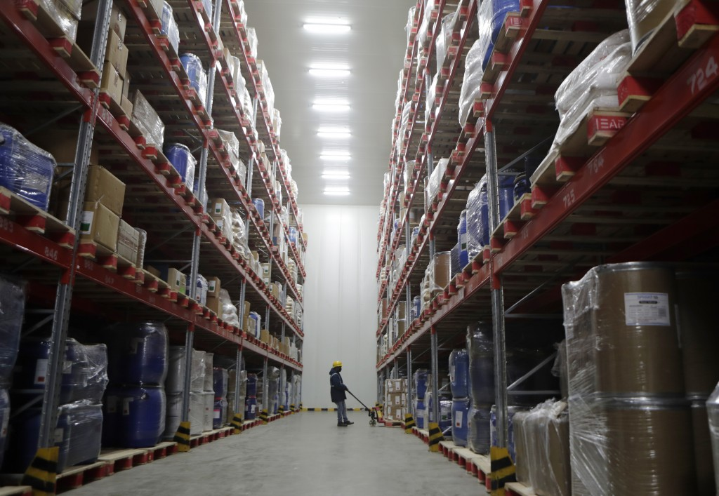 A worker moves boxes at Snowman Logistics, India's largest cold storage company in Taloja, on the outskirts of Mumbai, India, Saturday, Oct. 17, 2020....