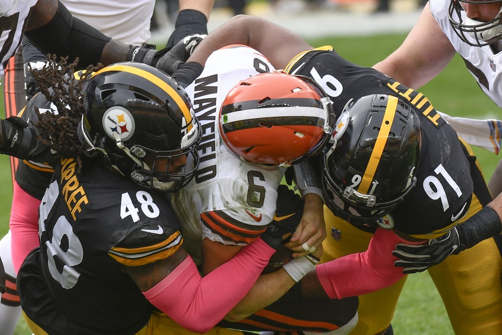 Cleveland Browns quarterback Baker Mayfield (6) is sacked by Pittsburgh Steelers defensive end Stephon Tuitt (91) and outside linebacker Bud Dupree (4...