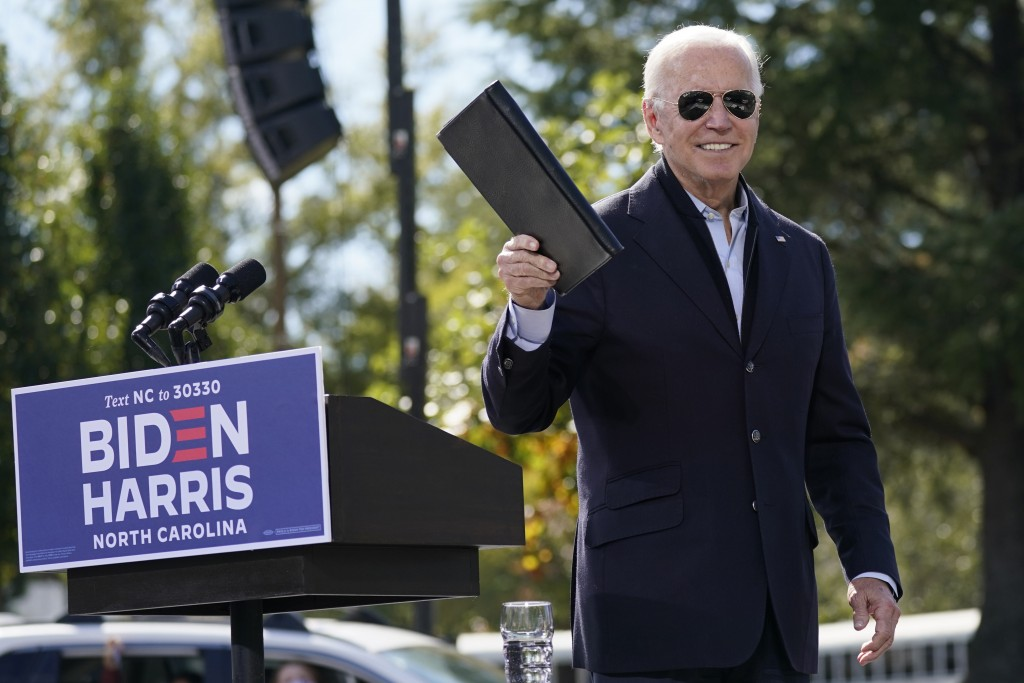 Democratic presidential candidate former Vice President Joe Biden turns from the podium after speaking during a campaign event at Riverside High Schoo...