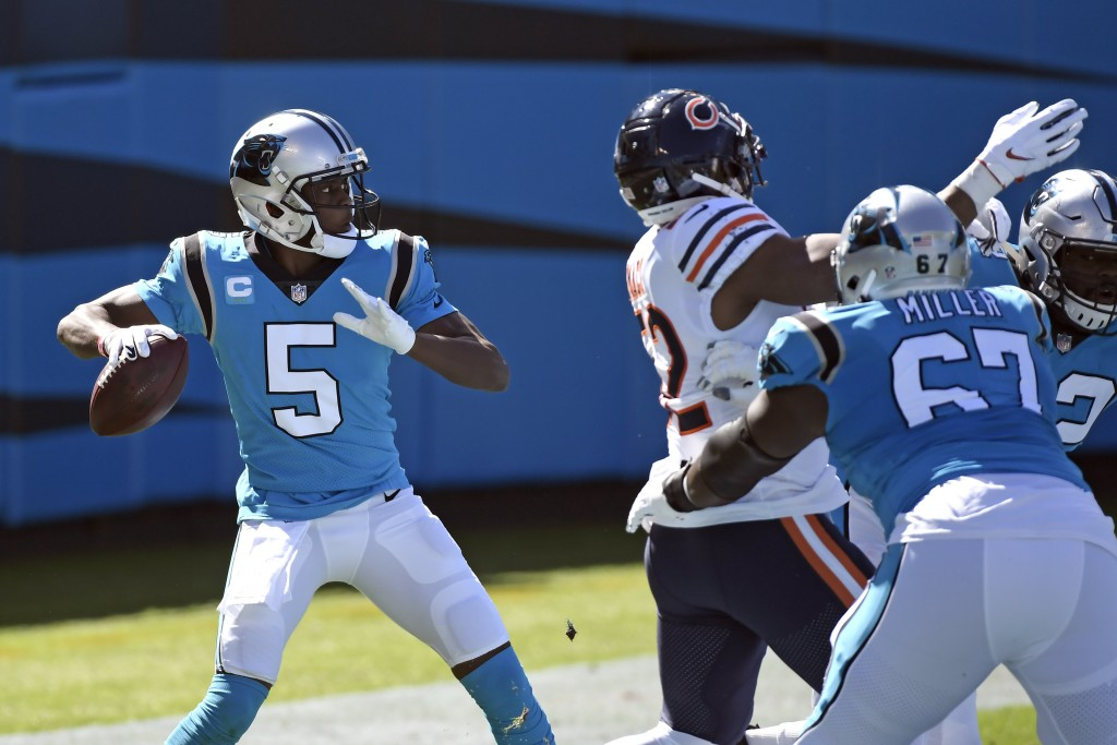 Carolina Panthers quarterback Teddy Bridgewater (5) looks to pass against the Chicago Bears during the first half of an NFL football game in Charlotte...