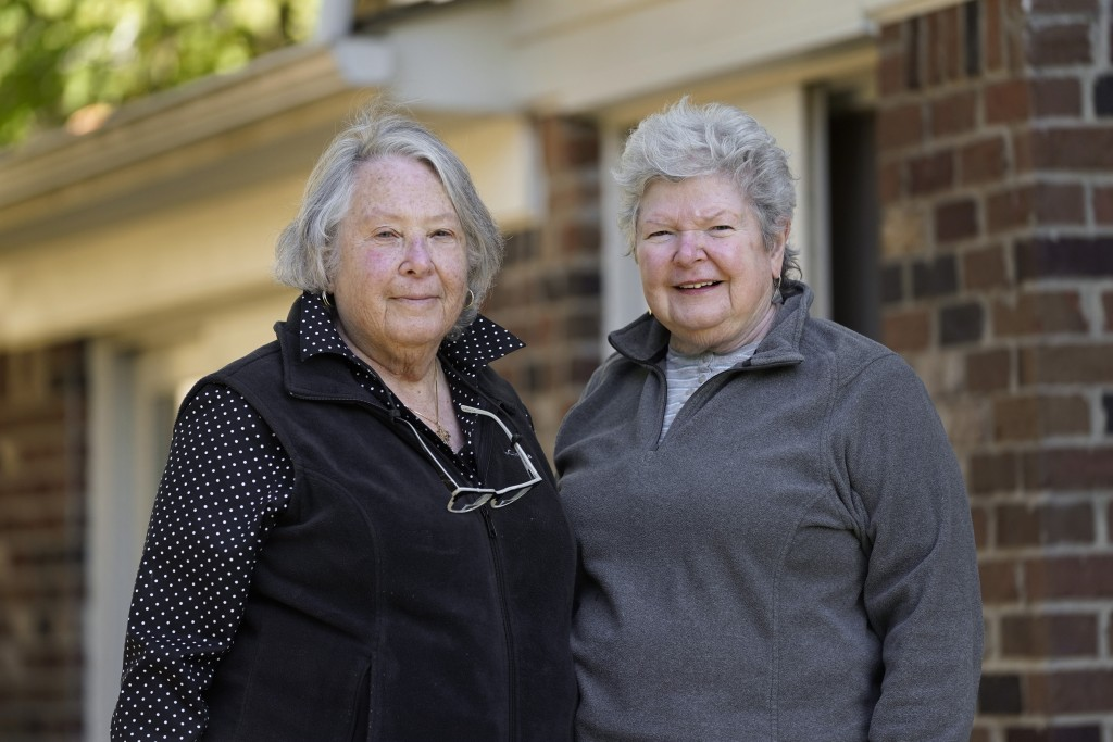 Ellen Ehrlich and Linda Northcraft pose for a portrait in Southfield, Mich., Tuesday, Oct. 13, 2020. They became active in Democratic politics when Gr...
