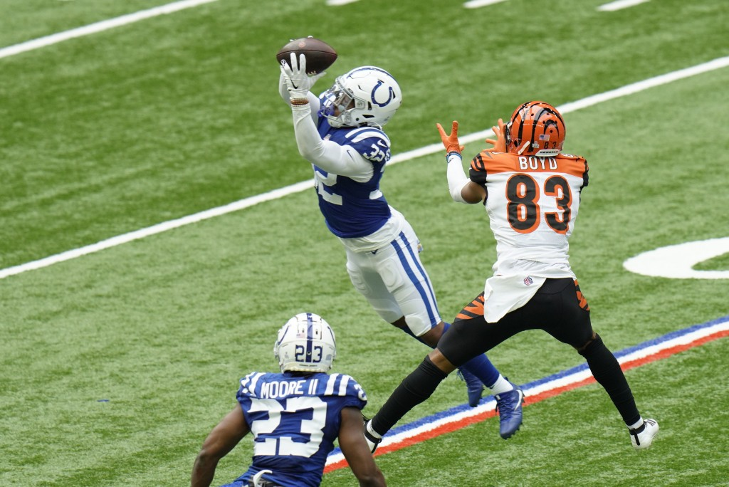 Indianapolis Colts' Julian Blackmon (32) intercepts a pass intended for Cincinnati Bengals' Tyler Boyd (83) during the second half of an NFL football ...